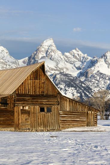 The Architecture of a Log Cabin Mimics the Structure of the Mountains Behind It-Robbie George-Photographic Print