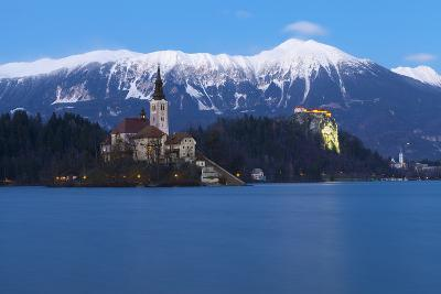 The Assumption of Mary Pilgrimage Church on Lake Bled and Bled Castle at Dusk, Bled, Slovenia-Miles Ertman-Photographic Print