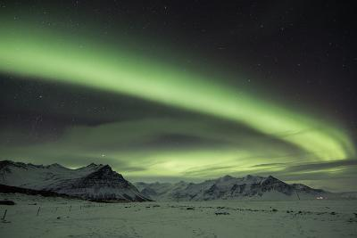 The Aurora Borealis in Iceland with Mountains in the Background-Alex Saberi-Photographic Print