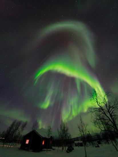 The Aurora Borealis Over a Sami Village House-Babak Tafreshi-Photographic Print