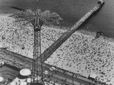 The Beach at Coney Island Looking Through Parachute Drop Tower at Crowded Beach--Photographic Print