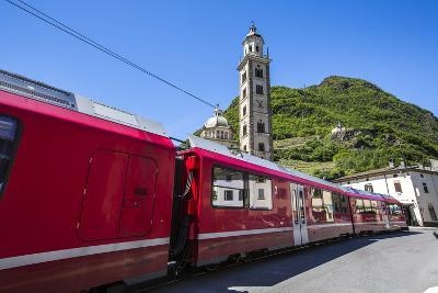 The Bernina Express Train Passes Near the Sanctuary of Madonna Di Tirano, Lombardy, Italy-Roberto Moiola-Photographic Print