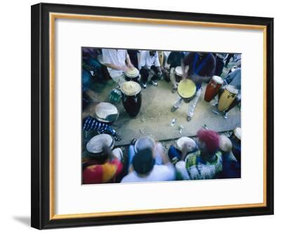 The Blur of a Frenzied Beat in a Circle of Spontaneous Drumming-Stephen St. John-Framed Photographic Print