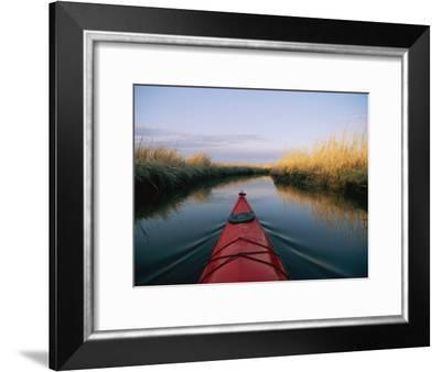 The Bow of a Kayak Leads the Way Through a Marsh Channel-Skip Brown-Framed Photographic Print