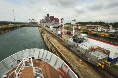 The Bow of a Small Passenger Ship as it Transits the Gatun Locks, Guided by a Metal Mule-Jonathan Kingston-Photographic Print