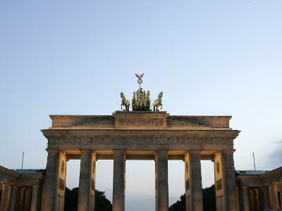The Brandenburg Gate Glows in the Evening Light in Berlin--Photographic Print