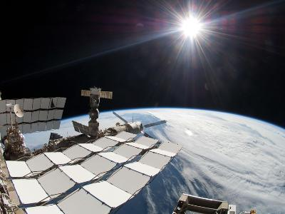 The Bright Sun, a Portion of the International Space Station And Earth's Horizon-Stocktrek Images-Photographic Print