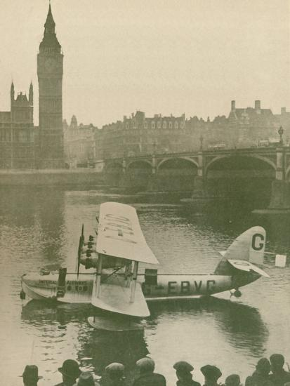 'The 'Calcutta' Flying-Boat Moored in the Thames opposite the Houses of Parliament', 1927-Unknown-Photographic Print