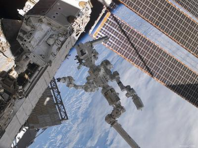 The Canadian-Built Dextre Robotic System in the Grasp of Canadarm2-Stocktrek Images-Photographic Print