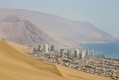 The City of Iquique, Chile, Sprawls Along the Base of Giant Sand Mountains-Mike Theiss-Photographic Print