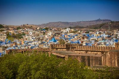 The City Wall of Mehrangarh Fort Towering over the Blue Rooftops in Jodhpur, the Blue City-Laura Grier-Photographic Print