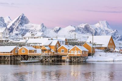 The Colors of Dawn Frame the Fishermen's Houses Surrounded by Frozen Sea, Sakrisoy, Reine-Roberto Moiola-Photographic Print