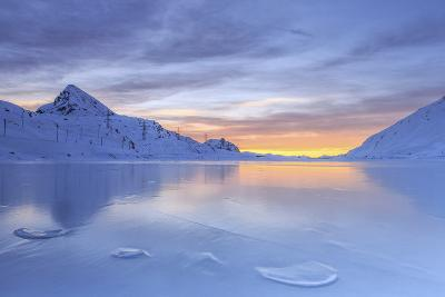 The Colors of Dawn Invading the Smooth Surface of Lago Bianco Exceptionally Icy-Roberto Moiola-Photographic Print