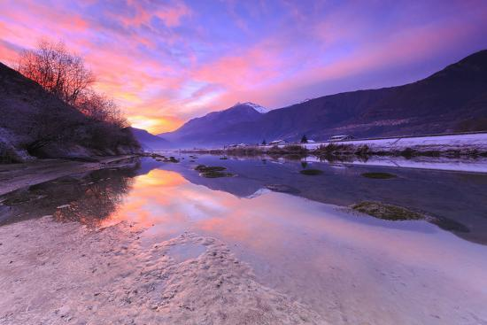 The colors of sunset are reflected in the Adda River, Valtellina, Lombardy, Italy, Europe-Francesco Bergamaschi-Photographic Print