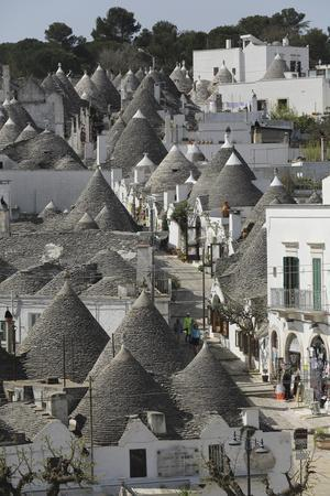 https://imgc.artprintimages.com/img/print/the-cone-shaped-roofs-of-trulli-houses-in-the-rione-monte-district-alberobello-apulia-italy_u-l-pwfelv0.jpg?p=0