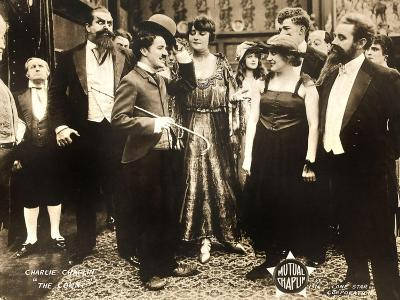 THE COUNT, foreground left: Charlie Chaplin, foreground second from right: Edna Purviance, 1916.--Art Print