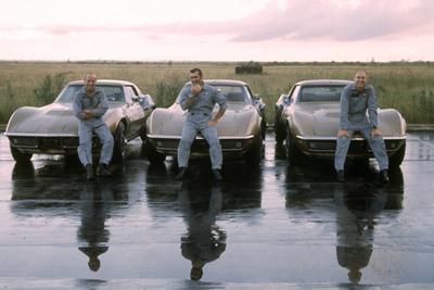 https://imgc.artprintimages.com/img/print/the-crew-of-apollo-12-as-they-sit-on-their-chevrolet-corvette-stingrays-september-23-1969_u-l-q130u4n0.jpg?artPerspective=n