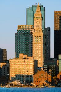 The Customs House Clock Tower and Boston skyline at sunrise, as seen from South Boston, Massachu...