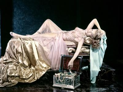 https://imgc.artprintimages.com/img/print/the-dance-of-the-seven-veils-by-william-dieterle-with-rita-hayworth-1953_u-l-pjubvc0.jpg?p=0
