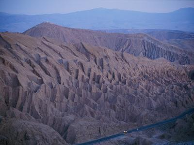 The Desert Dwarfs the One Road from Calama to San Pedro De Atacama-Joel Sartore-Photographic Print