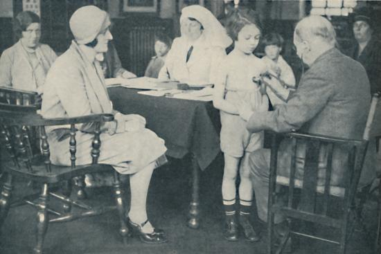 'The Doctor listening to a child's heart beat', c1935-Unknown-Photographic Print