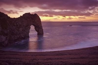 The Durdle Door Rock Arch at Dusk-Nigel Hicks-Photographic Print