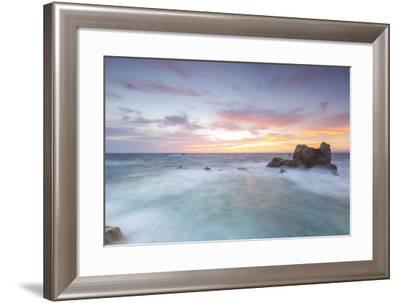 The fiery sky frames the waves crashing on rocks, Capo Testa, Santa Teresa di Gallura, Italy-Roberto Moiola-Framed Photographic Print