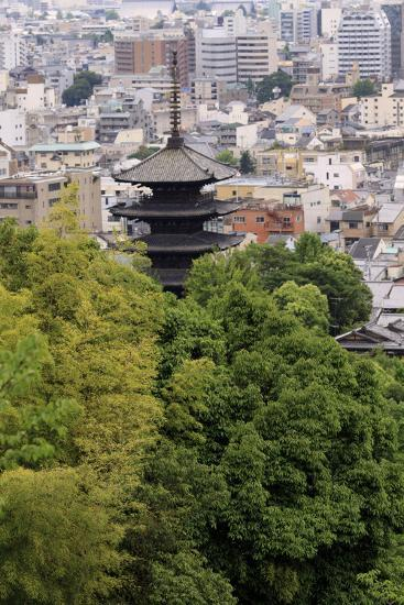 The Five-Tiered Pagoda of To-Ji, Looks Out over the Modern City of Kyoto, Japan-Paul Dymond-Photographic Print