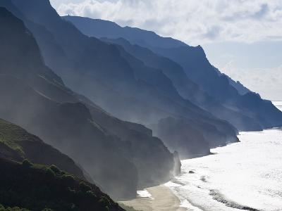 The Fluted Ridges of the Na Pali Coast Above the Crashing Surf on the North Shore of Kauai, Hawaii.-Sergio Ballivian-Photographic Print