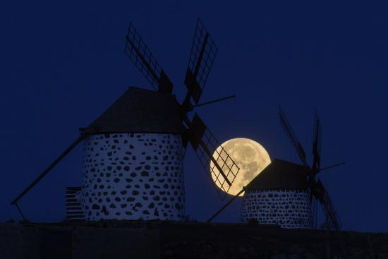 The Full Moon, a Wolf Moon, First Full Moon after the Winter Solstice, at Dawn Behind Windmills-Babak Tafreshi-Photographic Print