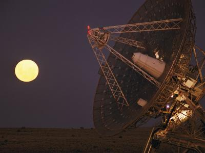 The Full Moon Rises Near a Satellite Dish-Joe Scherschel-Photographic Print