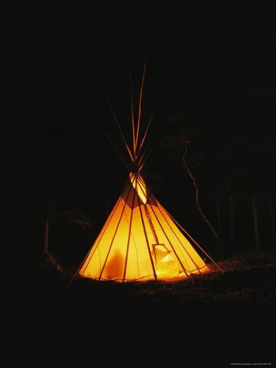 The Glow from a Campfire Makes a Shadow on a Tepee-Raymond Gehman-Photographic Print