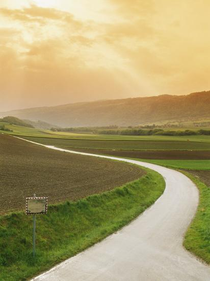 The Golden Sun Glows Through Cloud Cover to Illuminate a Country Road-Richard Nowitz-Photographic Print