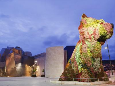 The Guggenheim, Designed by Architect Frank Gehry, and Puppy, the Sculpture by Jeff Koons-Christian Kober-Photographic Print