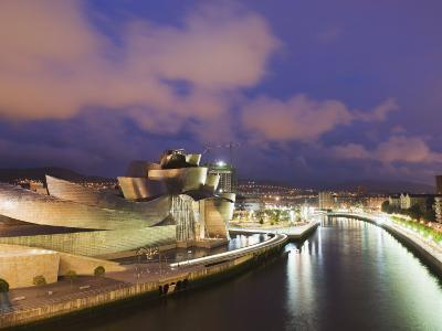 The Guggenheim, Designed by Canadian-American Architect Frank Gehry, on the Nervion River-Christian Kober-Photographic Print