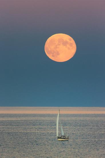 The Harvest Moon Rises over a Sailboat in Casco Bay-Robbie George-Photographic Print