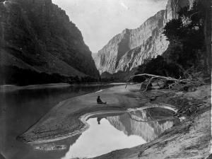 The Heart of Lodore, Green River, Shows Frederick S. Dellenbaugh Sitting Alone