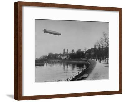 The Hindenburg Airship of Zeppelin Design Flying over City Where it was Fabricated
