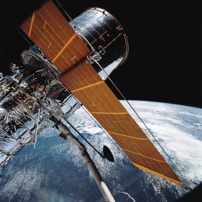 The Hubble Space Telescope Backdropped by Planet Earth--Photographic Print