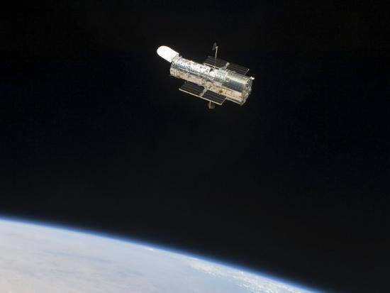 The Hubble Space Telescope in Orbit Above Earth--Photographic Print