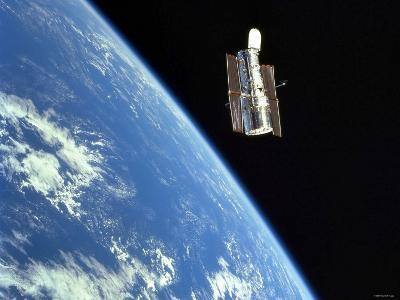 The Hubble Space Telescope with a Blue Earth in the Background-Stocktrek Images-Photographic Print