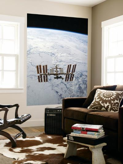 The International Space Station in Orbit Above Earth-Stocktrek Images-Wall Mural