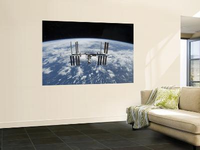 The International Space Station in Orbit Above the Earth--Wall Mural