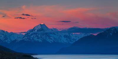 The Last Rays of Setting Sun Strike Peak of Aoraki (Mount Cook) Beyond Shores of Lake Pukaki-Garry Ridsdale-Photographic Print