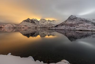 The Light of the Moon and Snowy Peaks Reflected in the Cold Sea Lit the Night at Svolvaer-Roberto Moiola-Photographic Print
