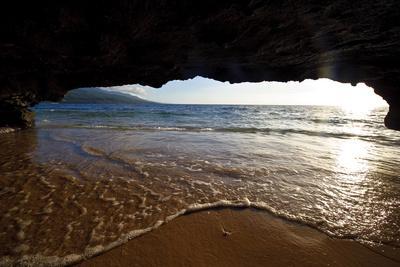 The Lip of a Foamy Wave Laps a Sandy Beach Inside an Ocean Cave-Jason Edwards-Premium Photographic Print