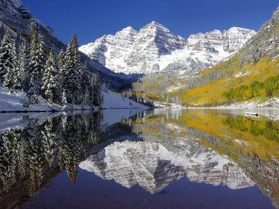 The Maroon Bells Casting Reflections in a Calm Lake in Autumn-Robbie George-Premium Photographic Print
