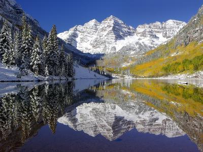 The Maroon Bells Casting Reflections in a Calm Lake in Autumn-Robbie George-Photographic Print