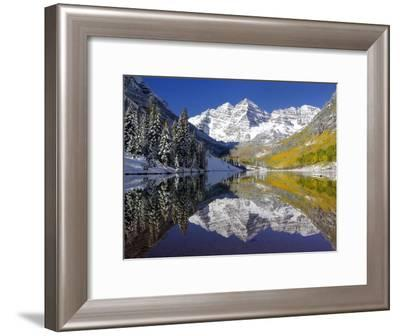 The Maroon Bells Casting Reflections in a Calm Lake in Autumn-Robbie George-Framed Photographic Print