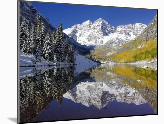 The Maroon Bells Casting Reflections in a Calm Lake in Autumn-Robbie George-Mounted Photographic Print